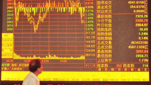 An investor watches the stock market at a stock exchange hall in Nanjing, China.