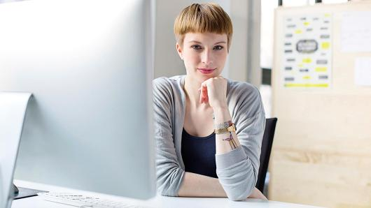 Millennial woman at office computer