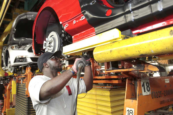 An assembly worker works on Ford Mustangs at the Ford Motor Flat Rock Assembly Plant in Flat Rock, Michigan.