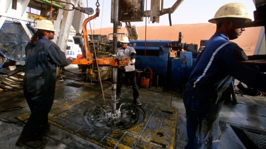 Workers drill at the Saudi Aramco oil field complex facilities at Shaybah, Saudi Arabia.