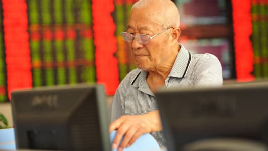 An investor checks stock information at a brokerage house in Fuyang, China.