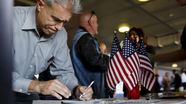 A job seeker fills out papers at a military job fair in San Francisco, California, August 25, 2015.