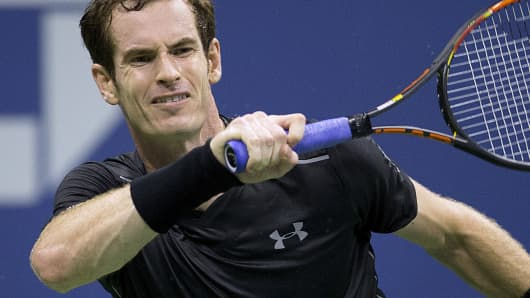 Andy Murray of Britain hits the ball to Nick Kyrgios of Australia during their first round match at the U.S. Open Championships tennis tournament in New York, September 1, 2015.