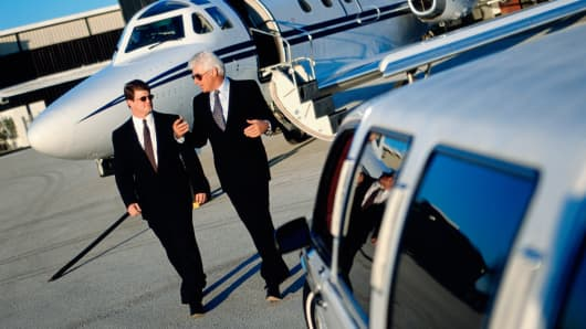 Businessmen with private plane