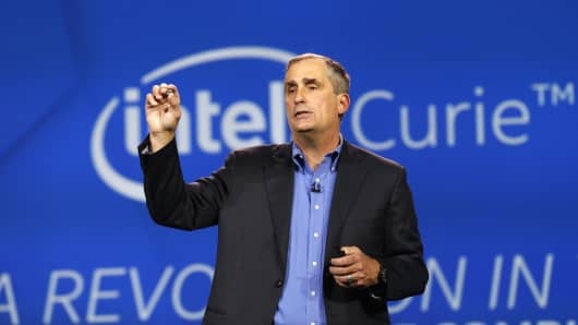 Brian Krzanich, chief executive officer of Intel Corp., holds the Curie module as he speaks during the 2015 Consumer Electronics Show (CES) in Las Vegas, Nevada, U.S., on Tuesday, Jan. 6, 2015.