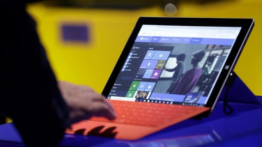 A visitor tries out Microsoft Corp.'s Windows 10 operating system on the Surface 3 tablet device during a launch event in Tokyo, Japan.
