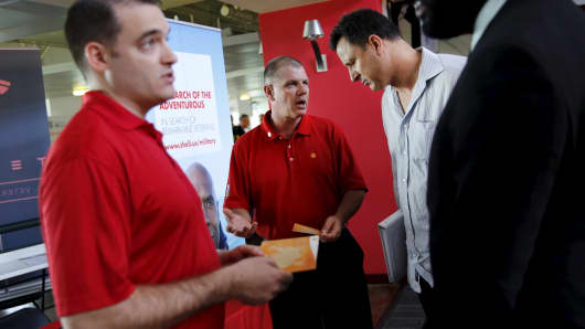 Recruiters from Shell Oil talk with job seekers at a military job fair in San Francisco, August 25, 2015.