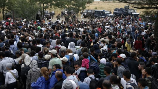 Syrian refugees and other migrants are stopped by Macedonian police at the Greek-Macedonian border, near the village of Idomeni, Aug. 22, 2015.