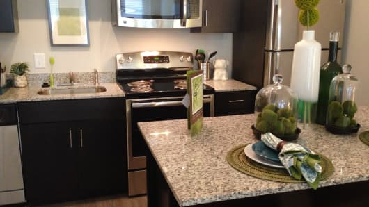 Granite countertops and stainless steel are standard in upscale student housing