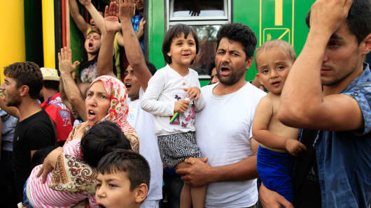 Migrants protest at the railway station in the town of Bicske, Hungary, September 3, 2015.