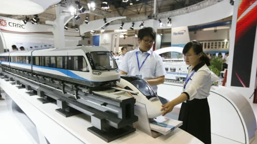 People look at booth of CRRC during UrTran 2015 on June 16, 2015 in Beijing, China.