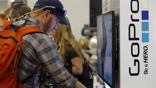 A man looks at GoPro Inc. cameras on display during the 2015 Outdoor Retailer Summer Market show at the Salt Palace Convention Center in Salt Lake City, Utah.