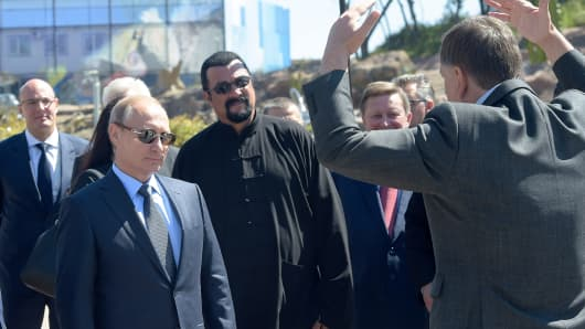 Vladimir Putin, left, with U.S. actor Steven Seagal, center, at the Eastern Economic Forum in Vladivostok on September 4. Russian news agency Tass reported Seagal was in the city for a martial arts competition.