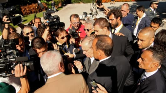 Italian Finance Minister Pier Carlo Padoan is bombarded by press on the sidelines of the European House-Ambrosetti Forum.