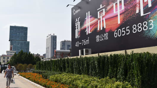 A billboard advertising the New Beijing Center in Beijing, Aug. 24, 2015.