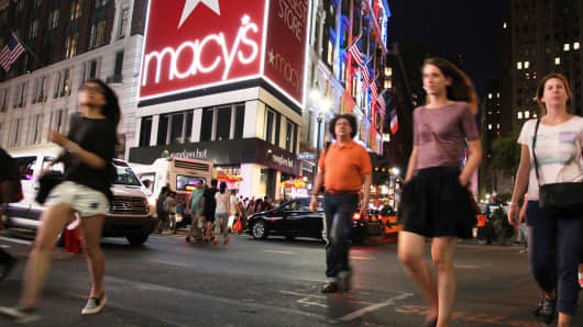 Pedestrians walking in front of Macy's in New York.