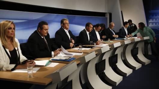Greek party leaders look on prior a television debate at the studios of Greek state broadcaster ERT. An opinion poll over the weekend showed that no party is projected to gain enough votes for an outright parliamentary majority, signaling coalition talks may be needed.