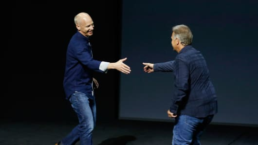 Kirk Koenigsbauer (left) is greeted by Apple's Phil Schiller as he takes the stage to discuss Microsoft Office for the iPad Pro during an Apple media event in San Francisco on Sept. 9, 2015.