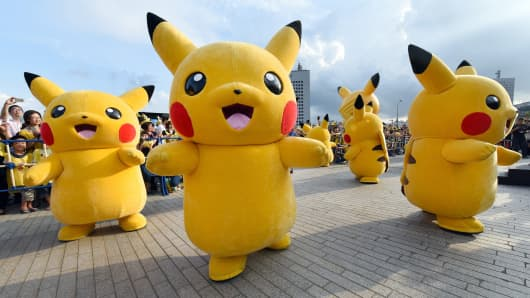 People dressed up as Pikachu, the famous character of Nintendo's videogame software Pokémon, dance in a Pikachu Outbreak event in Yokohama, Japan, in August.