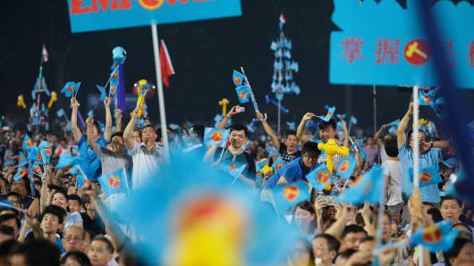 Worker's Party (WP) supporters react to a candidate's speech during a night rally on the final day of campaigning on September 9, 2015 in Singapore.