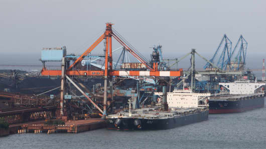 Dry-bulk ships are moored at a steel plant in Kamisu city, Ibaraki prefecture, Japan.