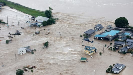 Floodwaters flow from the burst Kinugawa river into a residential area in Joso, Ibaraki Prefecture, on September 10, 2015. The Japanese city 50 km north east of Tokyo was flooded when the river burst its banks.