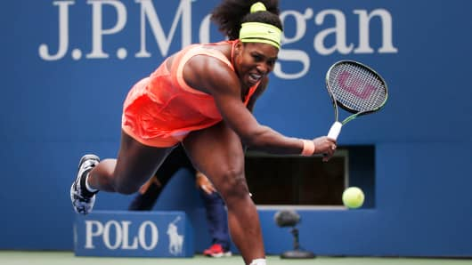 Serena Williams of the U.S. runs to chase down a return from Roberta Vinci of Italy in the third set during their women's singles semi-final match at the U.S. Open Championships tennis tournament in New York, September 11, 2015.