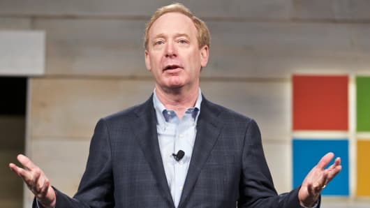 Microsoft General Counsel and Executive Vice President Brad Smith addresses shareholder during Microsoft Shareholders Meeting December 3, 2014 in Bellevue, Washington.
