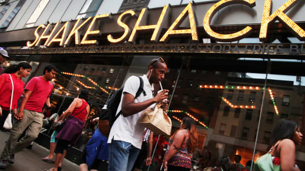 Pedestrians walk in front of a Shake Shack location in New York.