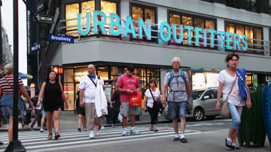 Pedestrians pass in front of an Urban Outfitters store in New York.