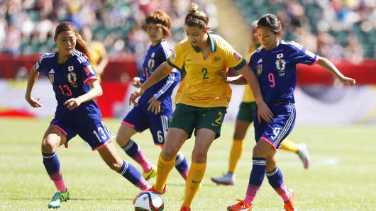 Larissa Crummer #2 of Australia tries to get past Rumi Utsugi #13 and Nahomi Kawasumi #9 of Japan during the FIFA Women's World Cup Canada Quarter Final match between Australia and Japan on June 27, 2015 in Canada.