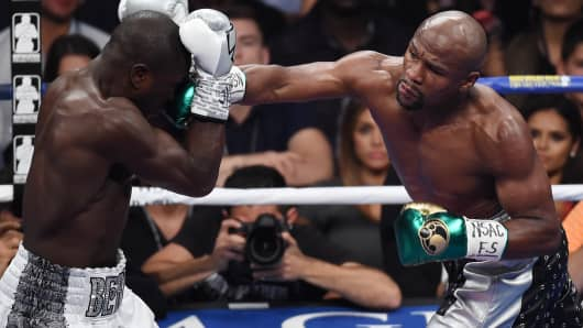 Floyd Mayweather Jr. throws a right at Andre Berto during their WBC/WBA welterweight title fight at MGM Grand Garden Arena on September 12, 2015 in Las Vegas, Nevada.