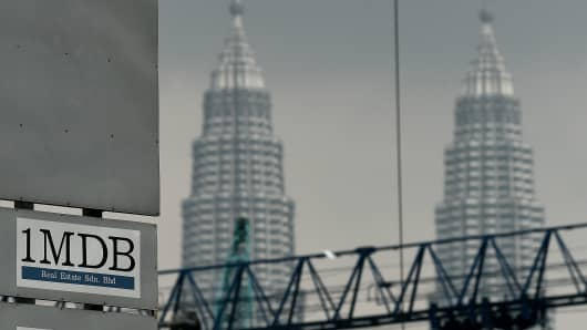 The 1MDB logo is seen on a billboard at the funds flagship Tun Razak Exchange under-development site in Kuala Lumpur on July 3, 2015.