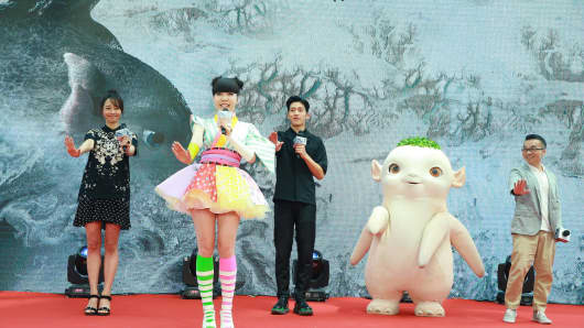 (L-R) Actress Bai Baihe, singer and actress MoMo Wu, actor Jing Boran and director Xu Chengyi attend the press conference for director Xu Chengyi's new movie 'Monster Hunt' on June 3, 2015 in Beijing, China.