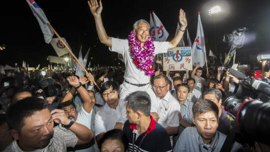 Lee Hsien Loong, Singapore's prime minister and leader of the People's Action Party (PAP), celebrates with supporters at an election results rally in Singapore on Saturday, Sept. 12, 2015.