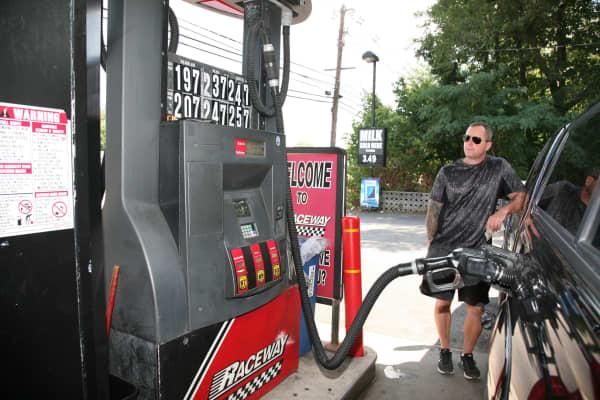 A motorist at a Raceway Petroleum station pumps gas in Woodbridge, New Jersey.