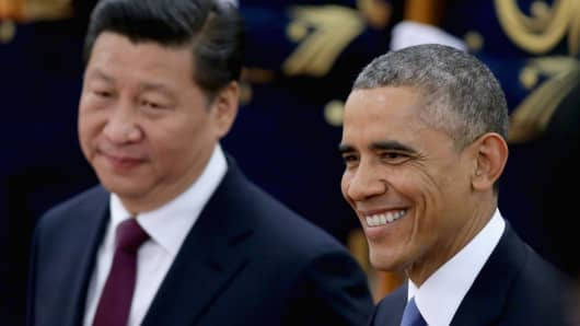 Chinese President Xi Jinping accompanies President Barack Obama to view an honor guard during a welcoming ceremony outside the Great Hall of the People on Nov. 12, 2014, in Beijing.