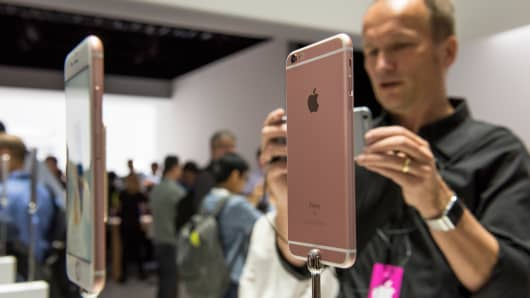 Attendees take photographs of the Apple Inc. iPhone 6s and iPhone 6s Plus smartphones after a product announcement in San Francisco, Sept. 9, 2015.