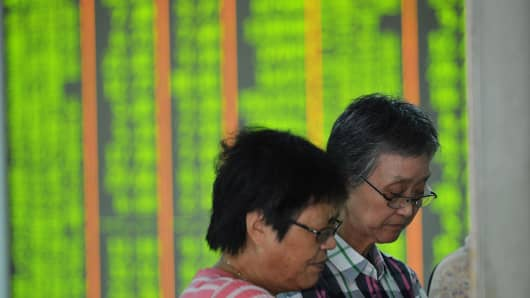 Investors observe stock market at a stock exchange hall in Hangzhou, Zhejiang Province of China.