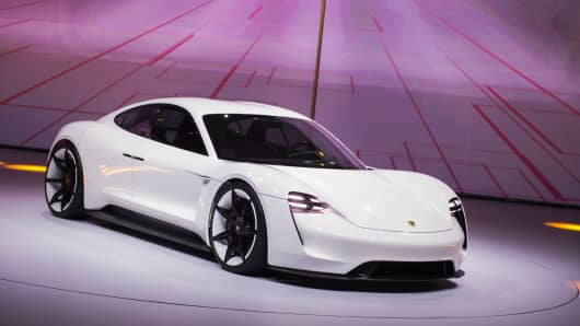 The new electric Porsche Mission E concept car is presented during the Volkswagen group night at the Fraport arena prior to the 66th IAA auto show in Frankfurt am Main, Western Germany, on September 14, 2015.