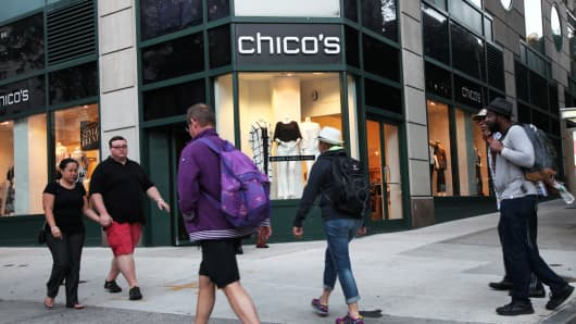 Pedestrians pass in front of a Chico's store in New York
