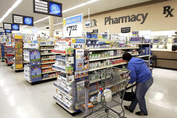A woman shops in the pharmacy area of a Wal-Mart store in Mount Prospect, Illinois.