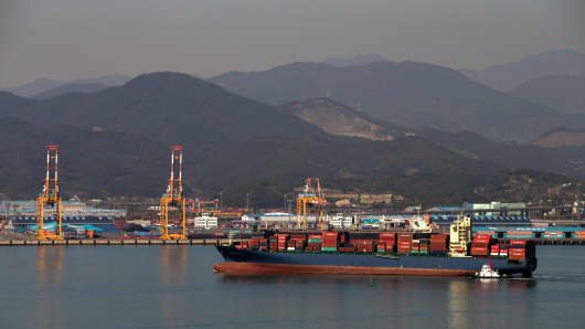 A container ship sails in the waters off Gwangyang, South Korea, on Wednesday, Nov. 5 , 2014.