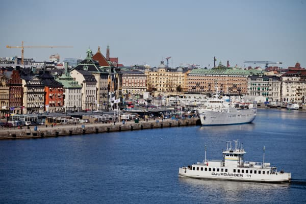 Vessels are seen on the waterfront in the old city area of Stockholm, Sweden