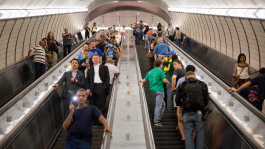 Passengers ride an escalator during the opening of the Hudson Yards subway station in New York.