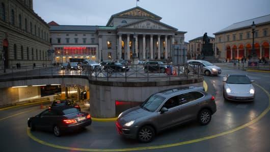 Vehicles enter an underground car park in Munich