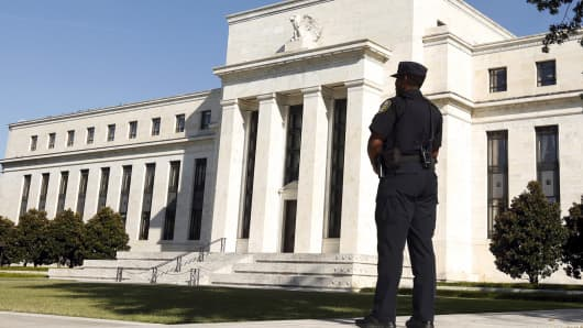 A Federal Reserve police officer keeps watch while posted outside the Federal Reserve headquarters in Washington.