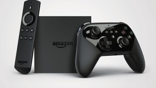 Amazon TV with remote and controller.