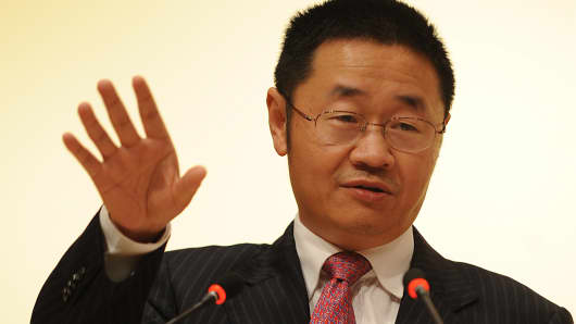 This photo from January 2010 shows Zhang Yujun, then-president of the Shanghai Stock Exchange, attending a press conference in Hong Kong. Zhang is currently the assistant chairman of the China Securities Regulatory Commission.