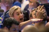 Traders in the Standard & Poor's 500 stock index options pit at the Chicago Board Options Exchange (CBOE) signal offers shortly before the Federal Reserve's decision on interest rates on September 17, 2015 in Chicago, Illinois.